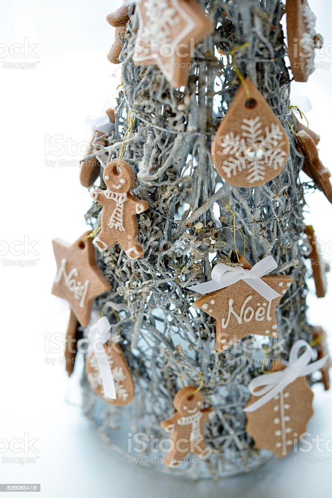 Gingerbread cookie on Christmas tree stock photo
