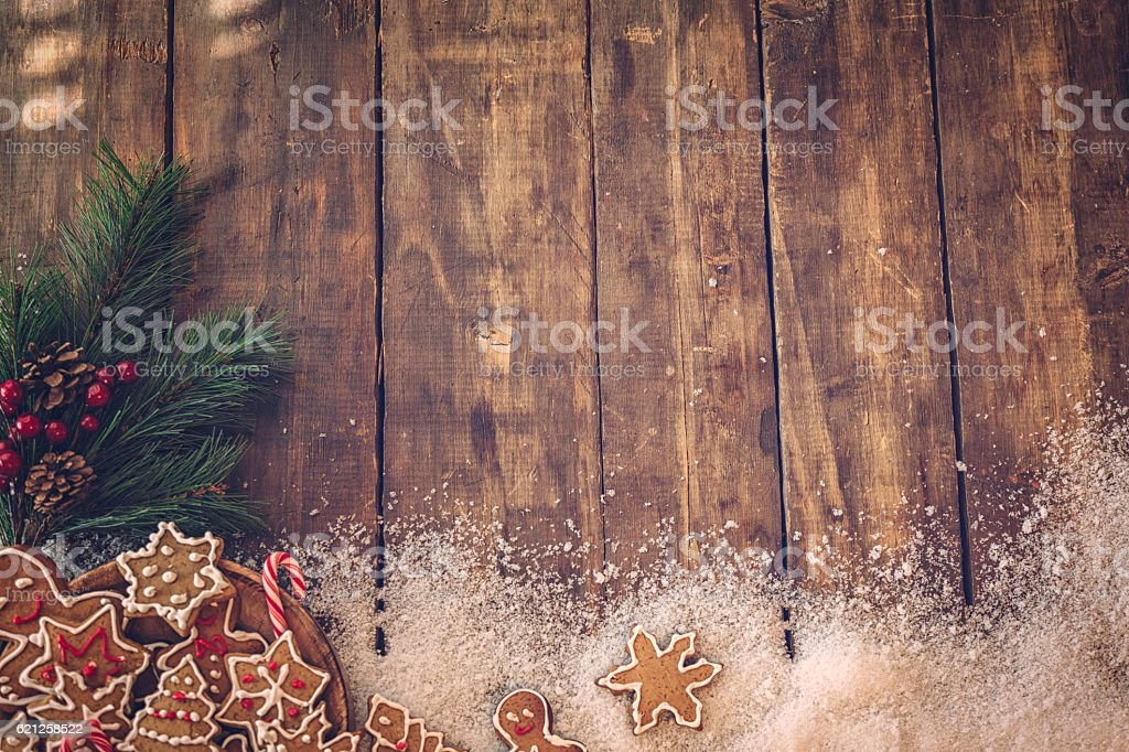 Gingerbread Cookies and Christmas Ornaments Decoration on Wooden...