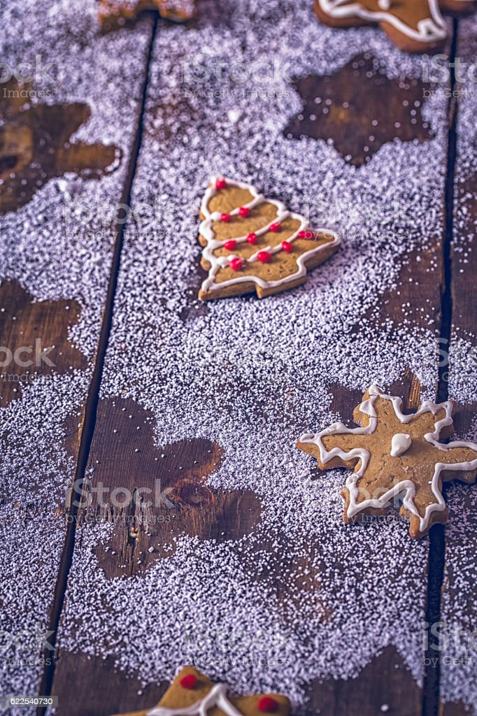 Gingerbread Cookies Decoration with Powdered Sugar on Wooden Background stock photo