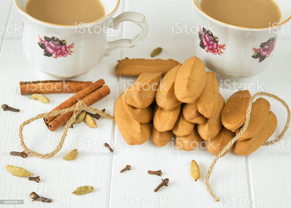 Gingerbread cookies on a white wooden table. stock photo