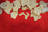 Gingerbread cookies on the red board, Chrismas background,