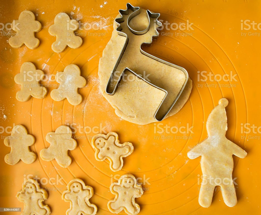 Gingerbread dough and deer cookies for christmas and cookie cutters stock photo