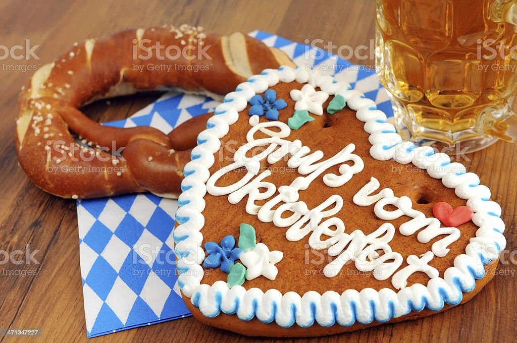 Gingerbread heart and pretzel on a napkin next to a mug stock photo