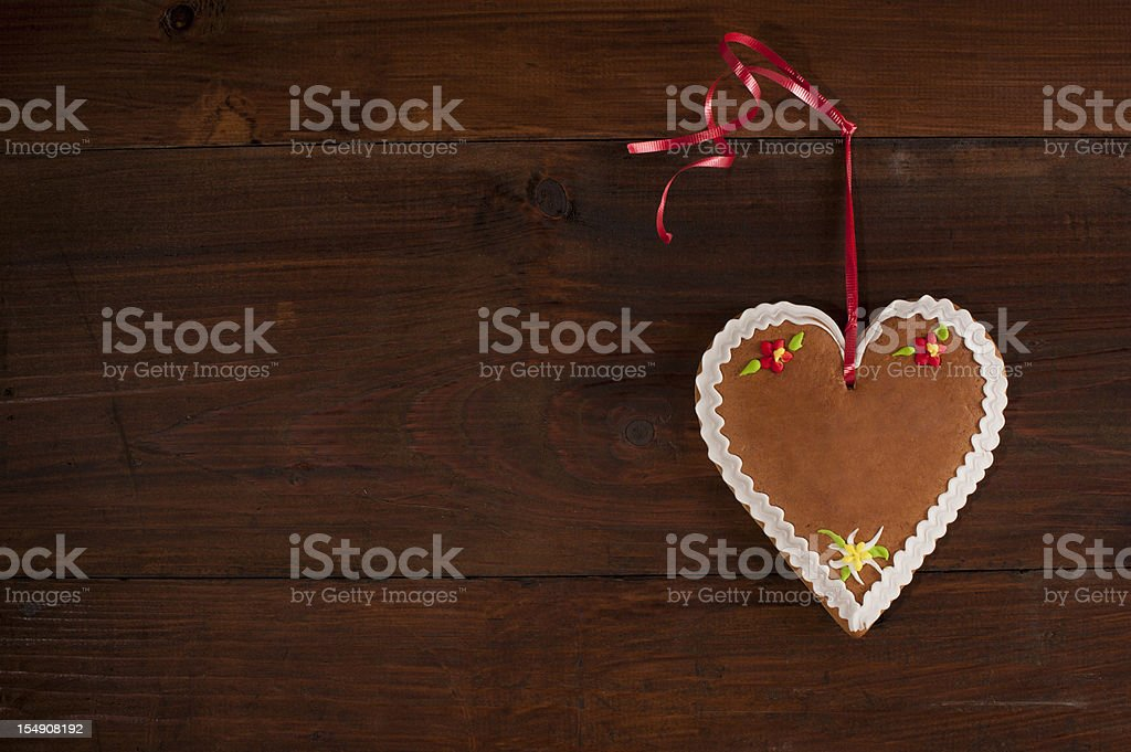 gingerbread heart on wood stock photo