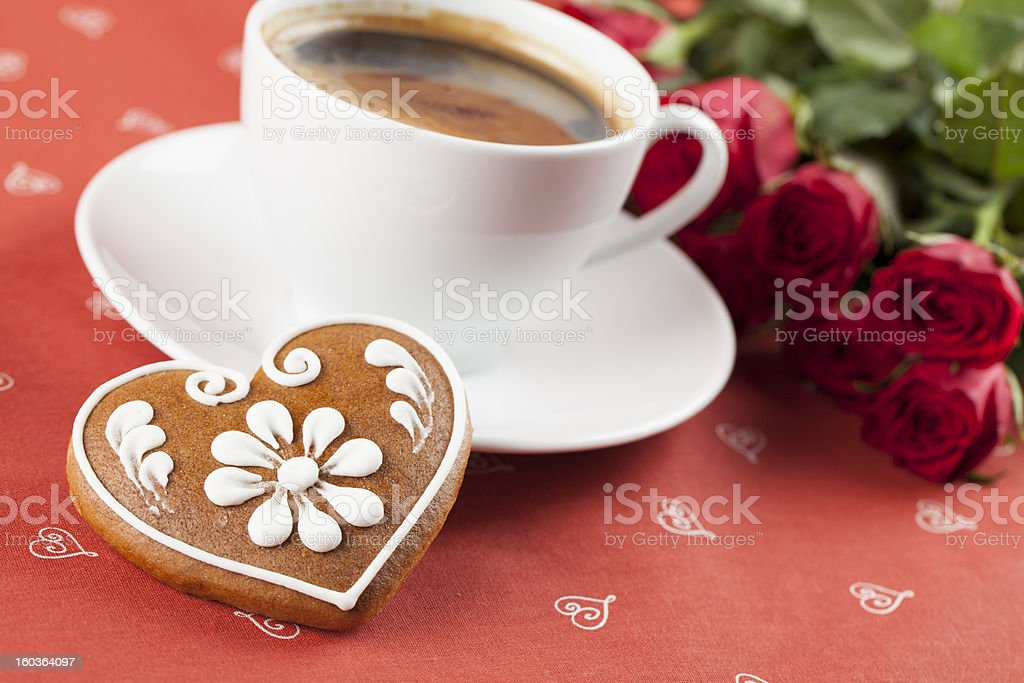 Gingerbread heart with coffee and roses royalty-free stock photo