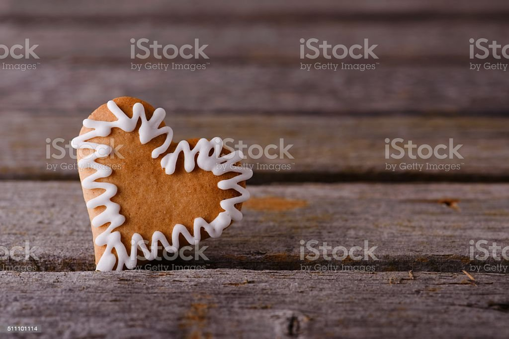 Gingerbread heart with white sugar line stock photo