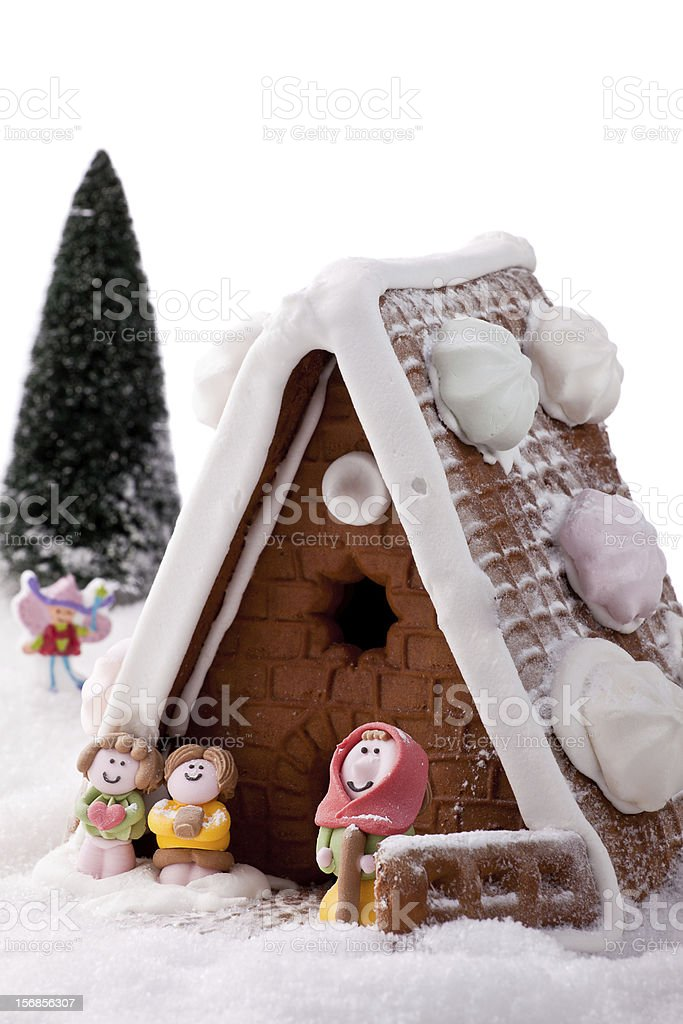 Gingerbread House Cake in the snow. stock photo