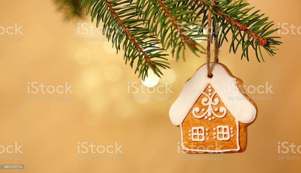 Gingerbread house on christmas tree stock photo