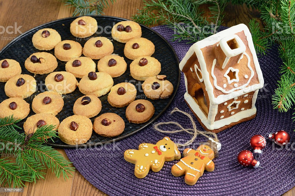 Gingerbread house with Christmas cookies royalty-free stock photo