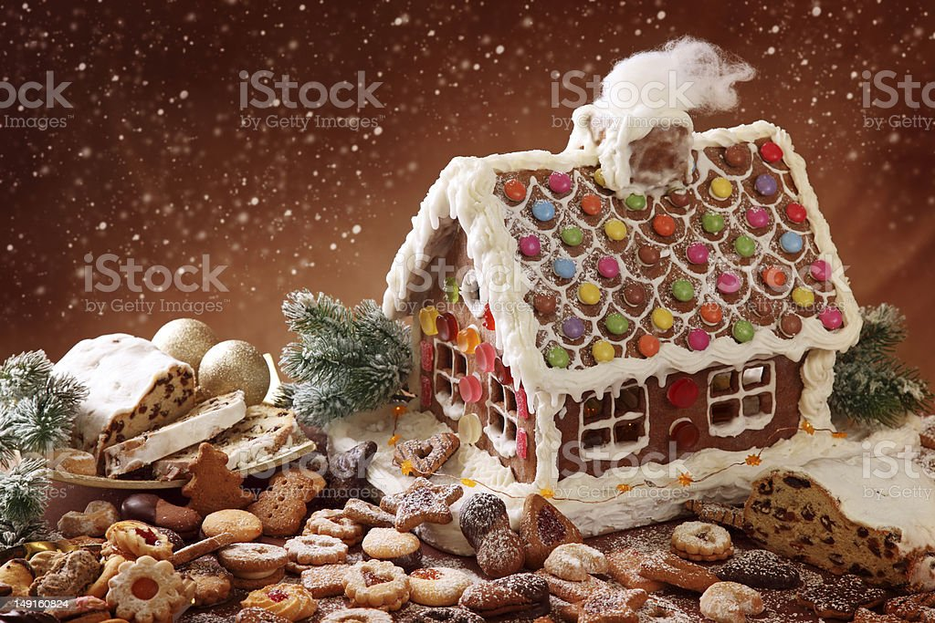 Gingerbread house with delicious candy surrounded by cookies royalty-free stock photo