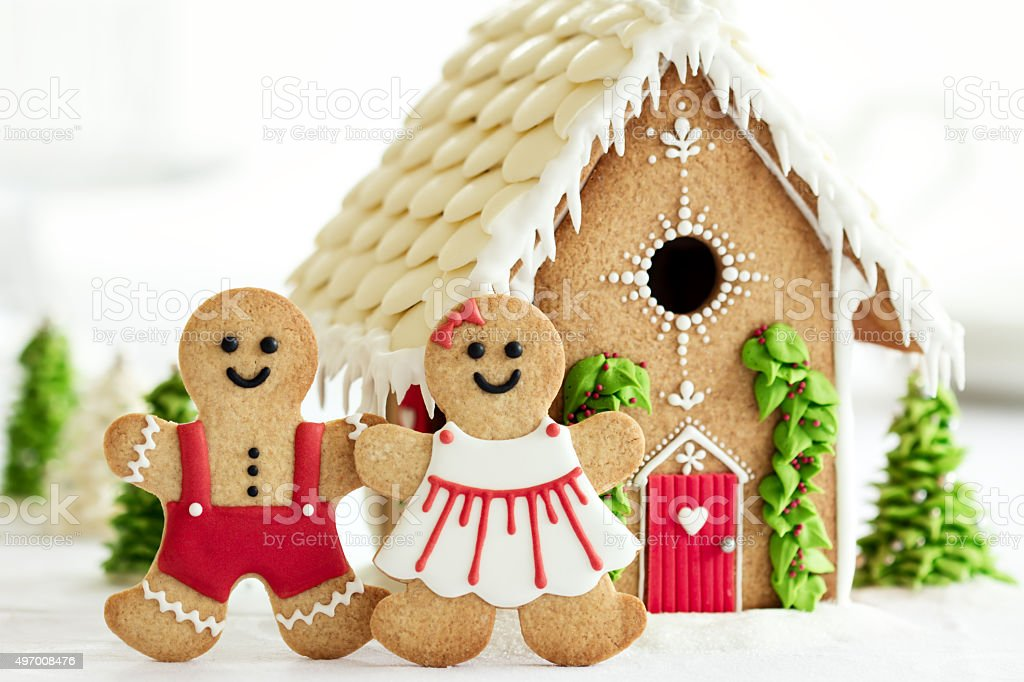 Gingerbread house with gingerbread couple stock photo