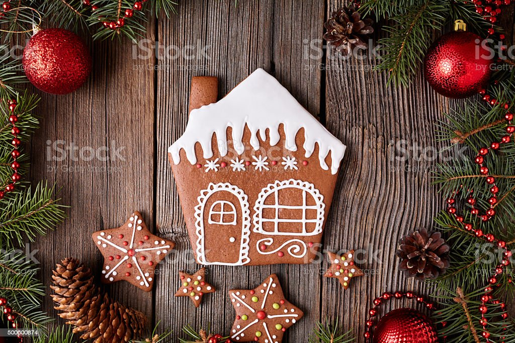 Gingerbread House With Stars Cookies Composition In Fir Tree Decorations Royalty Free Stock Photo