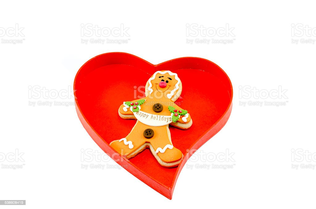 Gingerbread in a heart shaped box isolated on white royalty-free stock photo