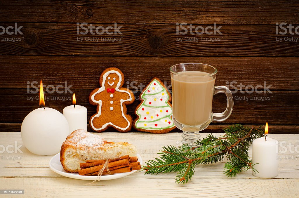 Gingerbread man and Christmas tree, cappuccino, fir twig stock photo
