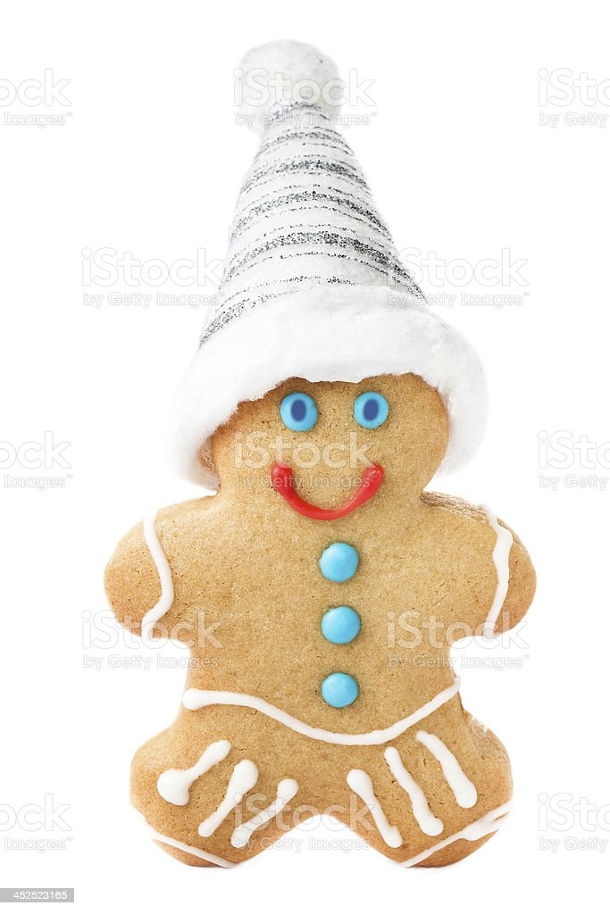 Gingerbread Man Christmas Cookie with Santa hat and magic stick stock photo