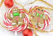 Gingerbread man Christmas lollipops closeup