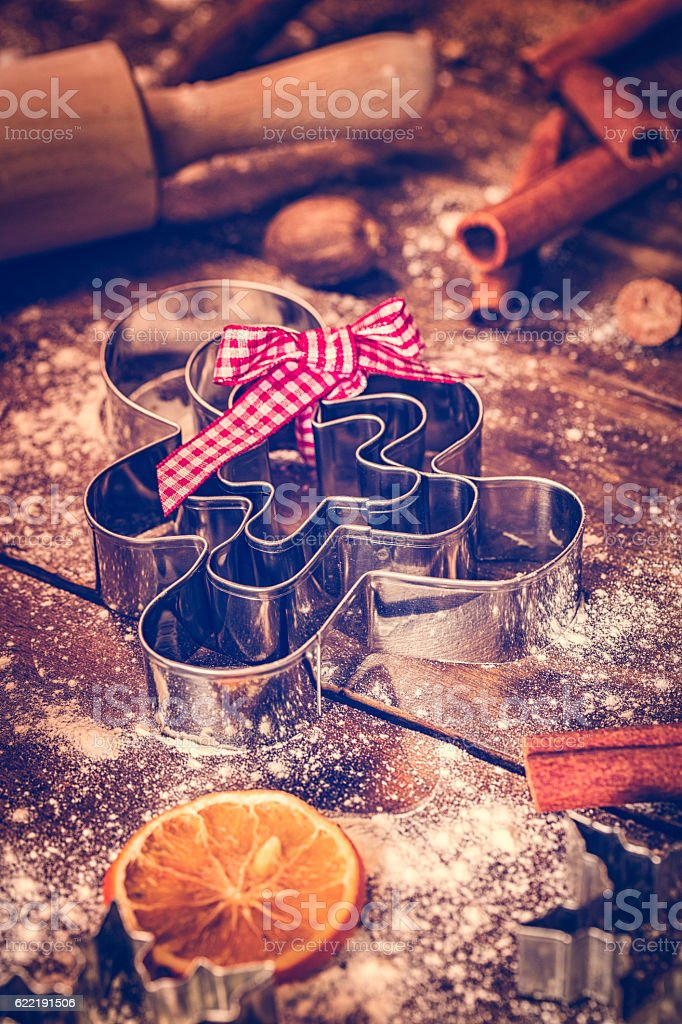 Gingerbread Man Cutters and Baking Utensils Ready for Christmas Baking stock photo