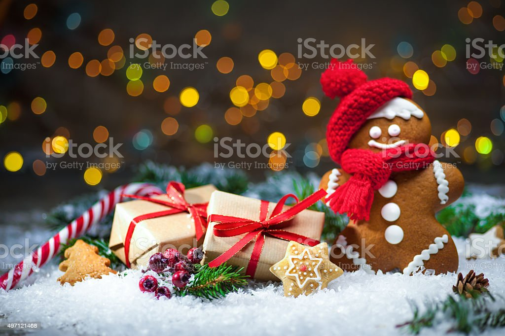 Gingerbread man with Christmas presents stock photo