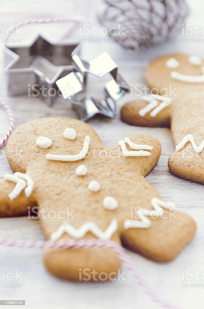 Gingerbread man with cookie cutters royalty-free stock photo