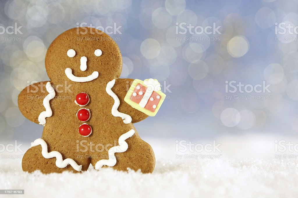 gingerbread  man with gift royalty-free stock photo