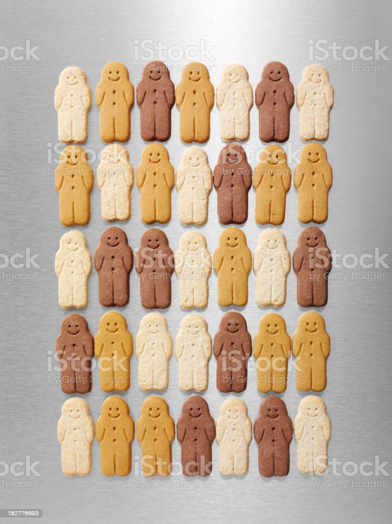 Gingerbread Men on Stainless Steel royalty-free stock photo