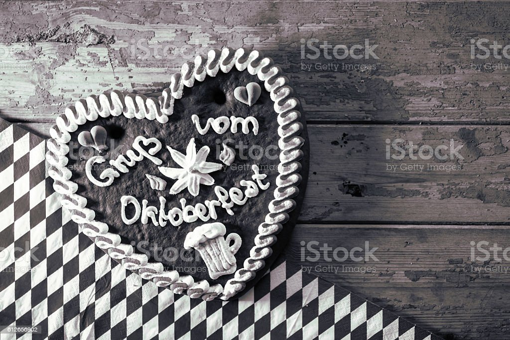 gingerbread Oktoberfest heart on rustic table in black white stock photo