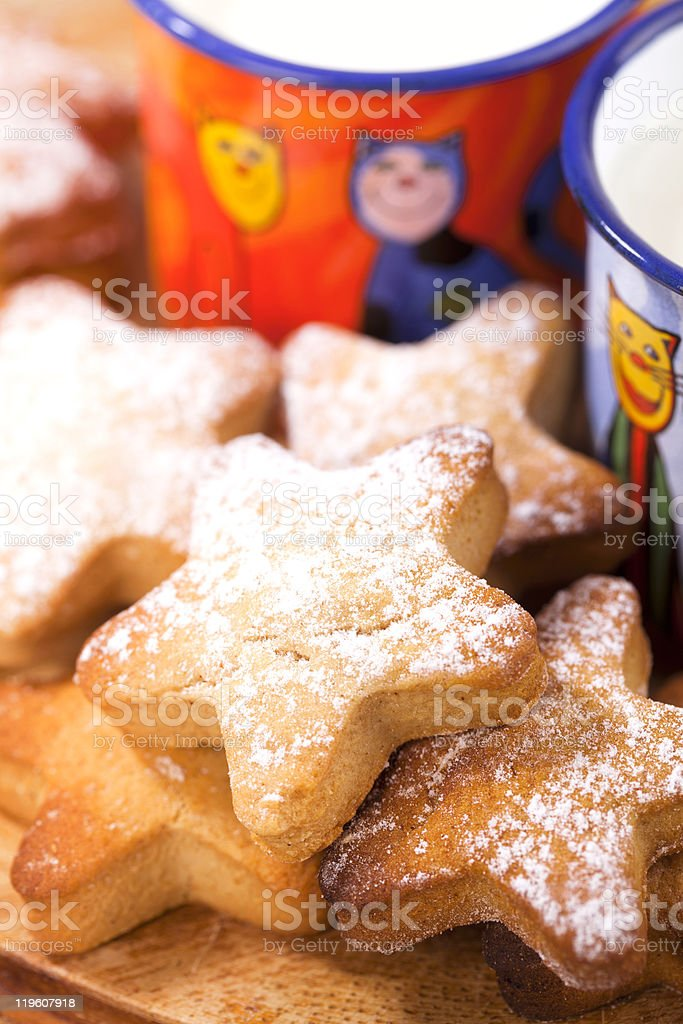 gingerbread  star cookies with kids milk stock photo