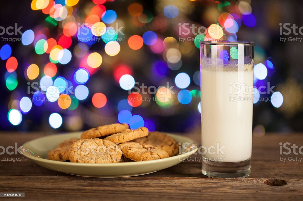 Gingerbread stars cookies and Milk for Santa Claus stock photo