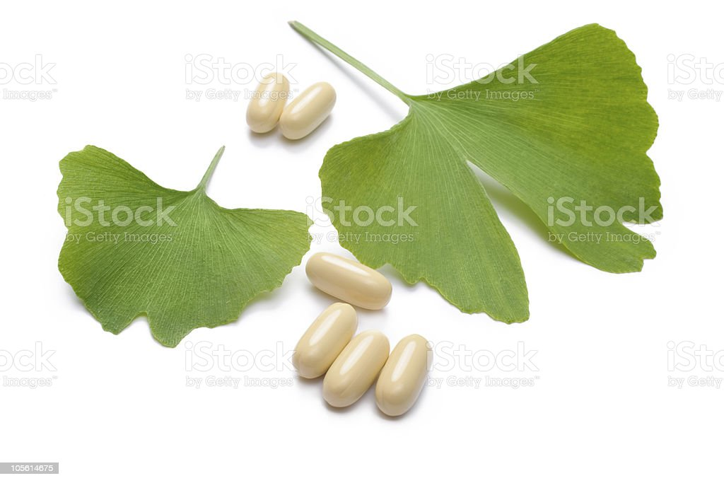 Ginkgo Biloba leaves and pills isolated on white background stock photo