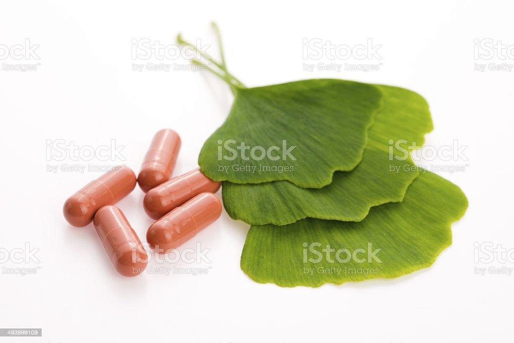 Ginkgo biloba leaves and pills stock photo