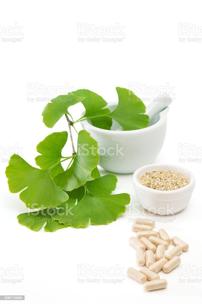 Ginkgo capsules with mortar and pestle stock photo