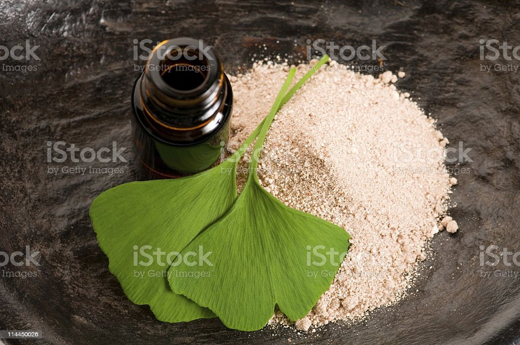 ginko biloba essential oil with fresh leaves - beauty treatment stock photo