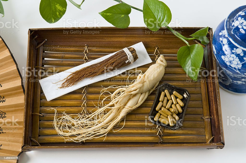 Ginseng, capsules and Dry Roots stock photo