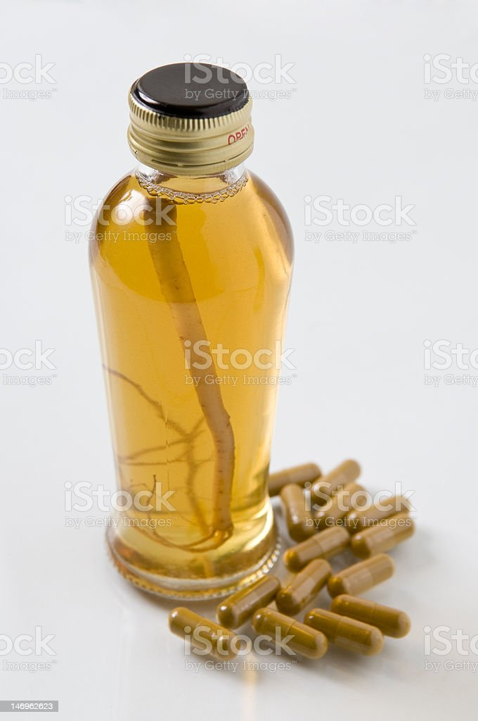 Ginseng Slices, Capsules and Extract Liquid royalty-free stock photo