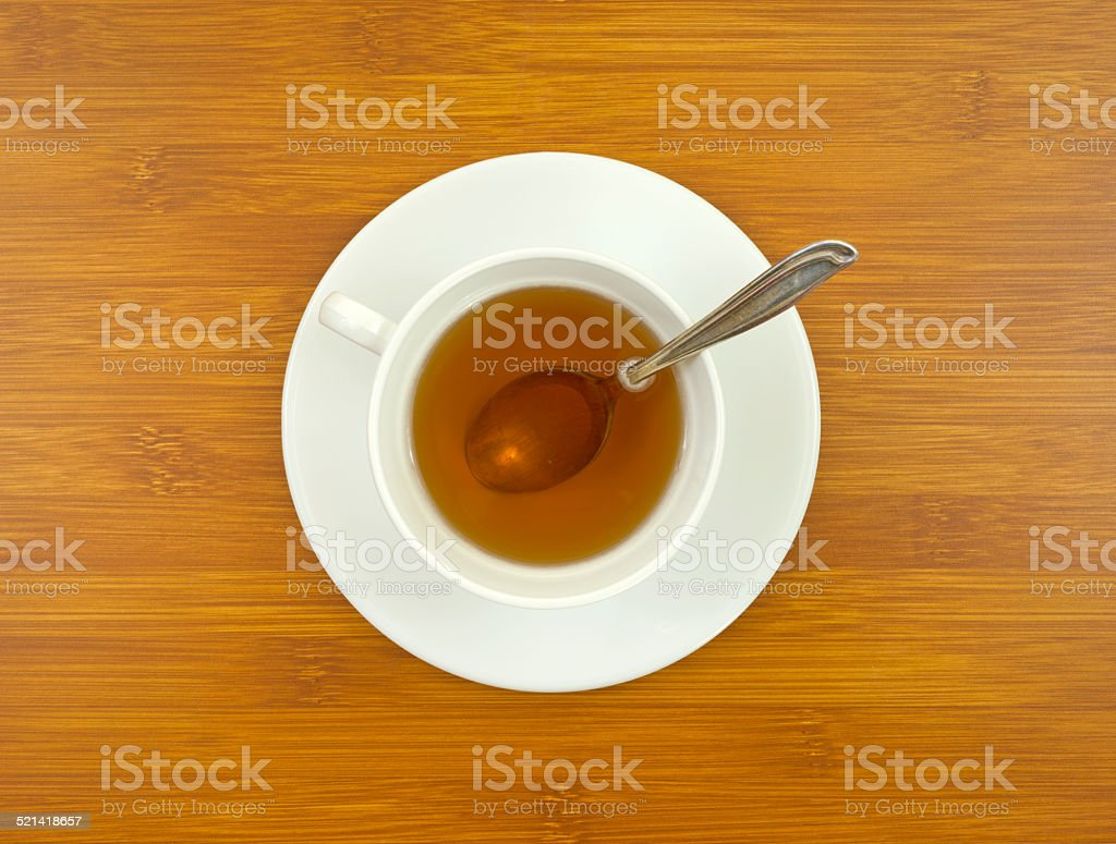 Ginseng tea with spoon on tabletop stock photo