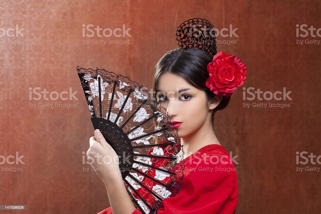 Gipsy flamenco dancer Spain girl with red rose stock photo