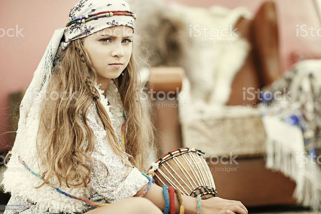gipsy girl posing with drum royalty-free stock photo