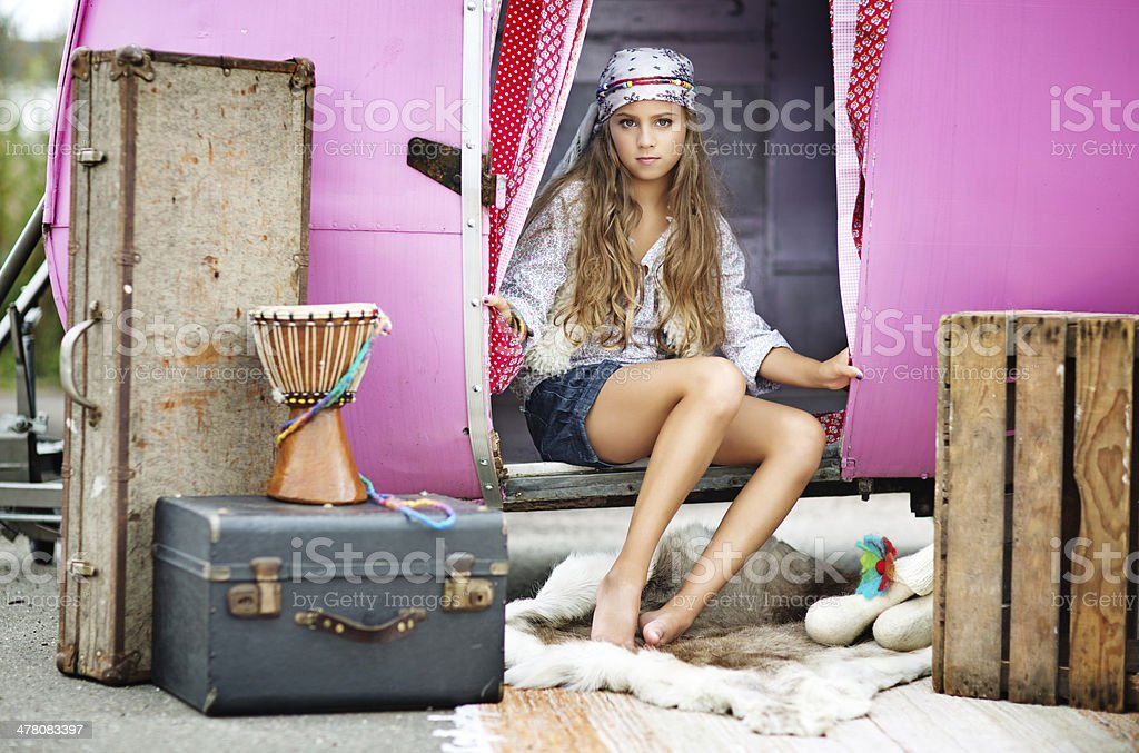 gipsy girl sitting at the entrance of caravan royalty-free stock photo