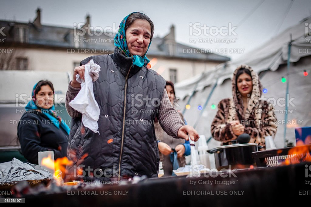 Gipsy woman at the barbecue stock photo