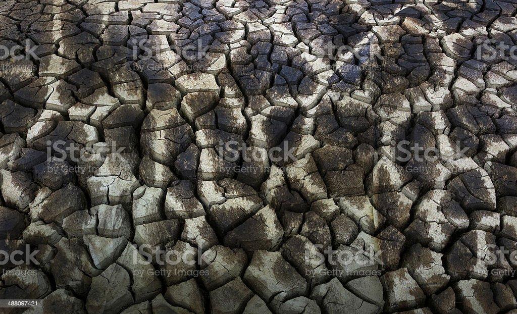 Giraffe skin and dry earth cracks background stock photo