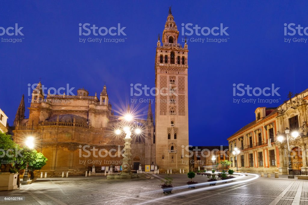 Giralda and Seville Cathedral at night, Spain stock photo