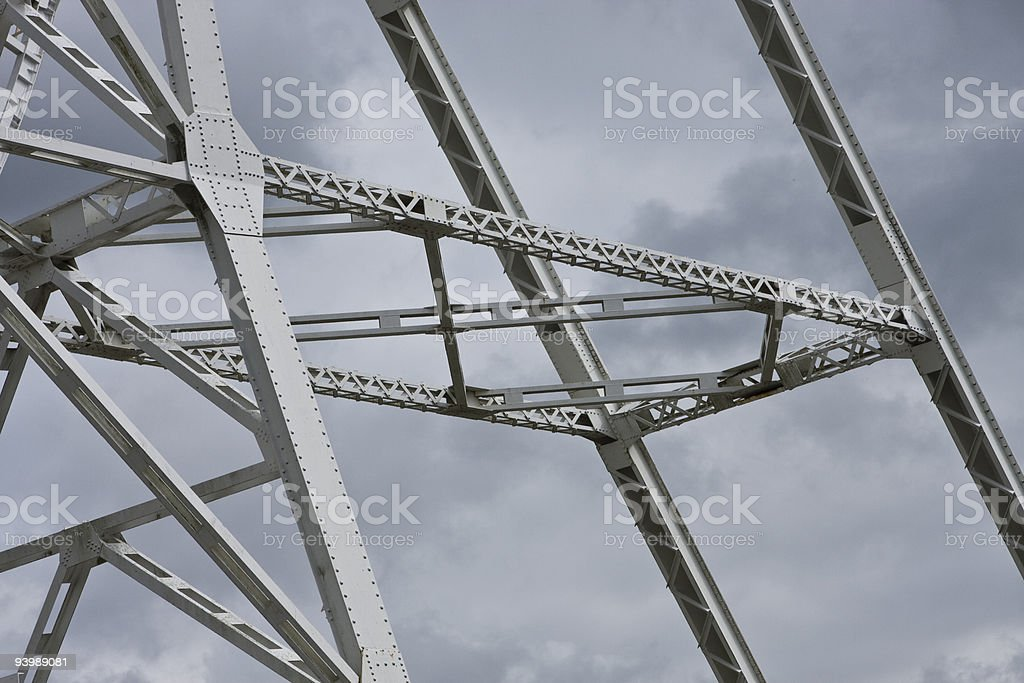 Girders against cloudy sky stock photo
