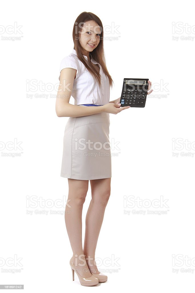 Girl, 16 years old, shows digits on a calculator. stock photo