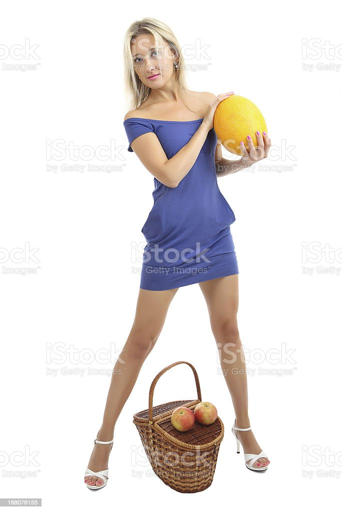 Girl 34 years old, in blue, skin-tight dress with melon. stock photo