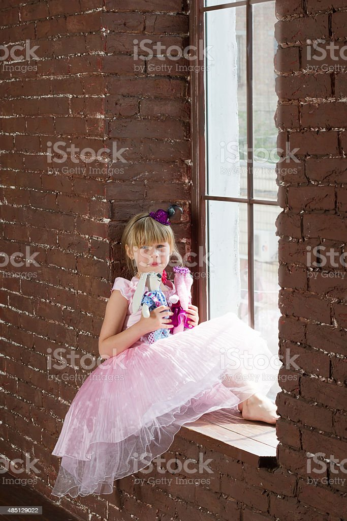 Girl 6 years old with homemade toys stock photo