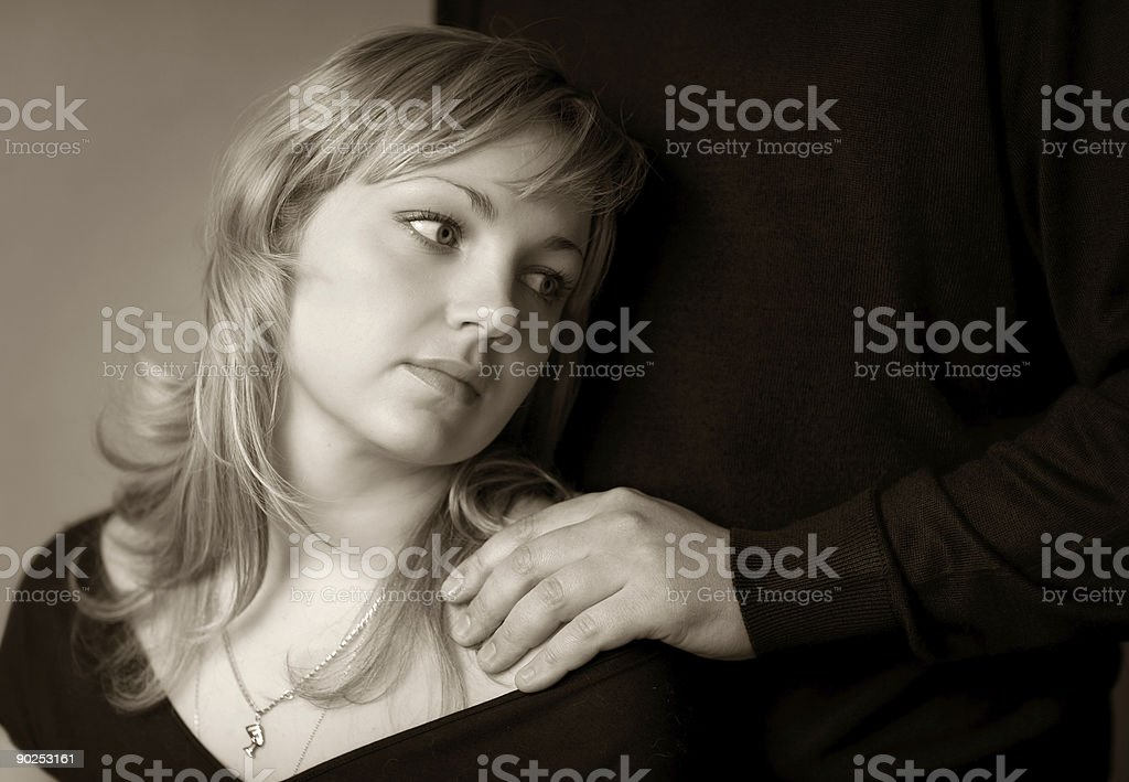 Girl about the man (To look better on a black) royalty-free stock photo