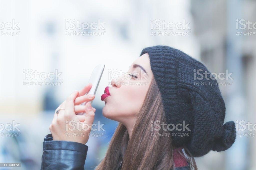 Girl adoring her cellphone. stock photo