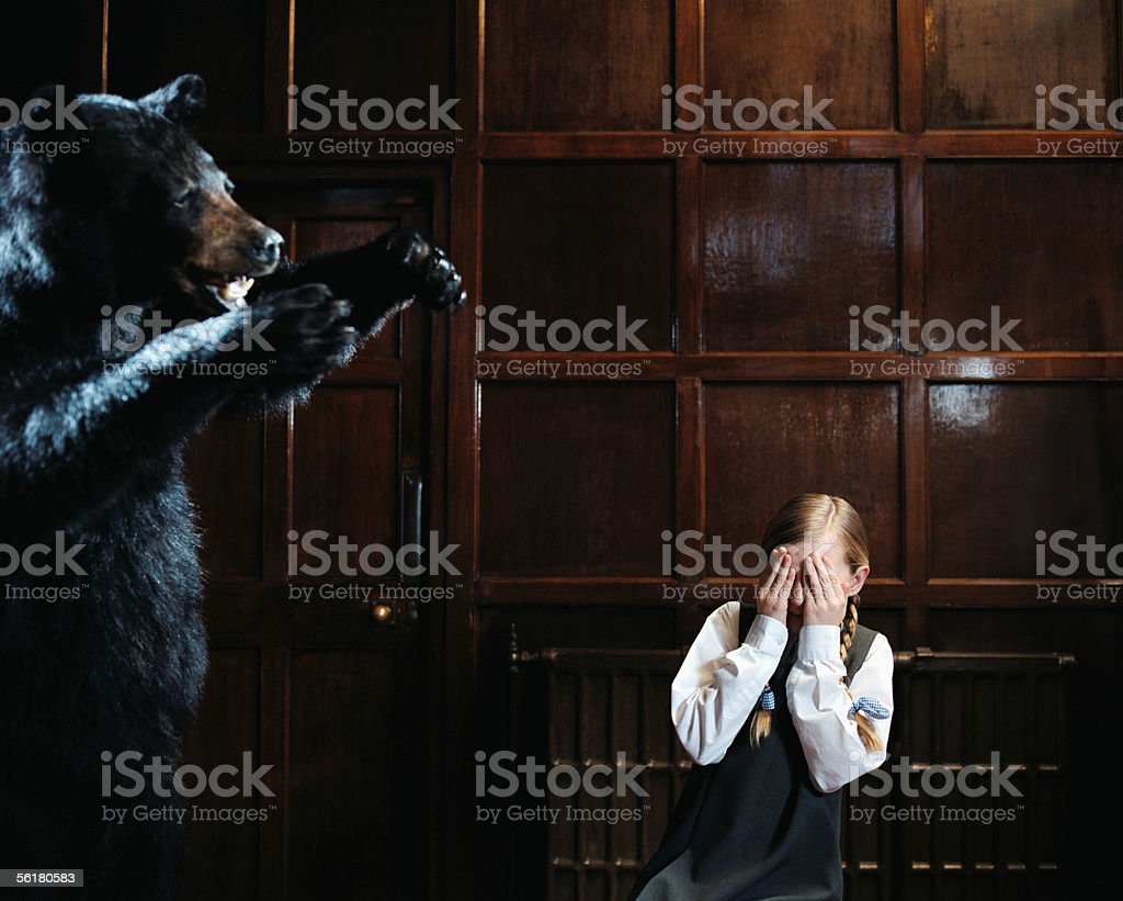 Girl afraid of stuffed bear royalty-free stock photo