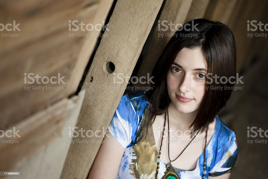 Girl Against a barn wall royalty-free stock photo