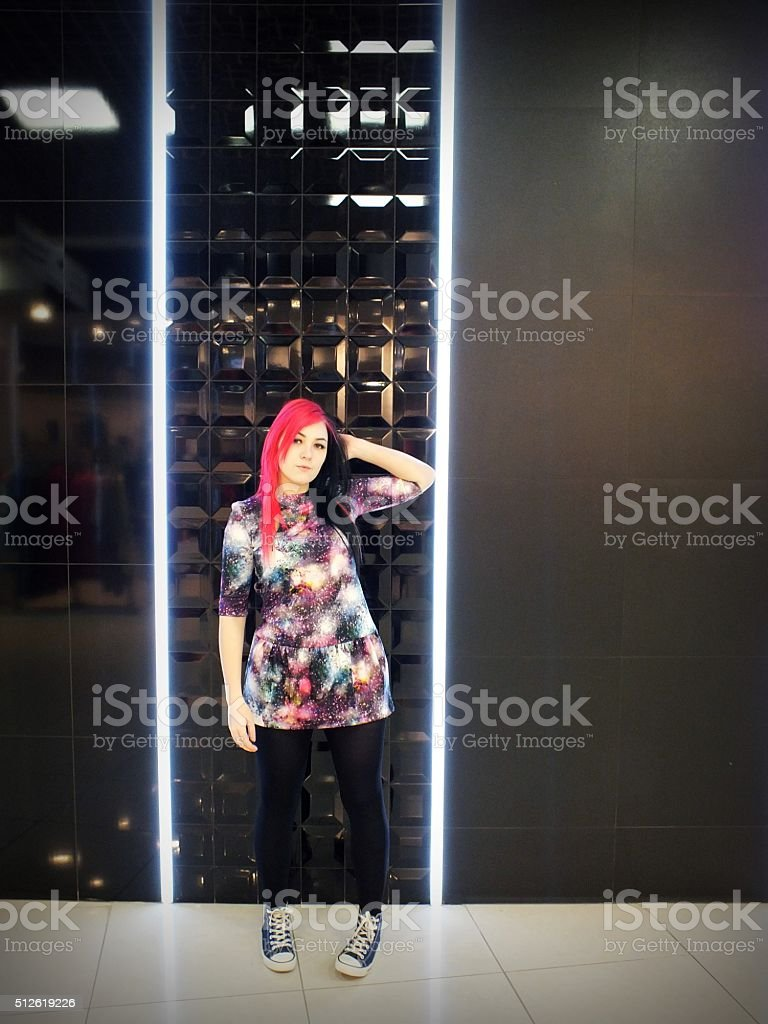 Girl against a black wall stock photo